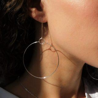 Short silver terrestrial earrings on model