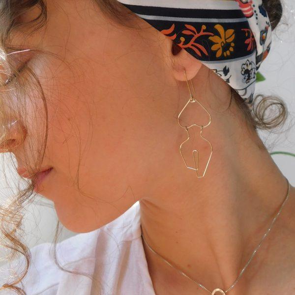 self earrings on model