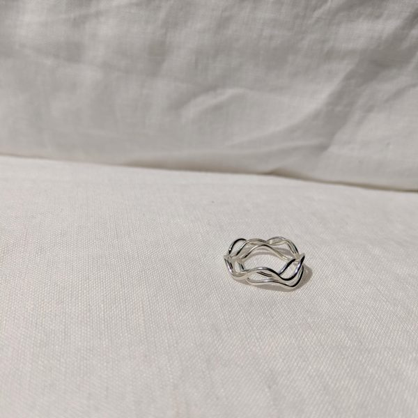 stack of silver wave rings
