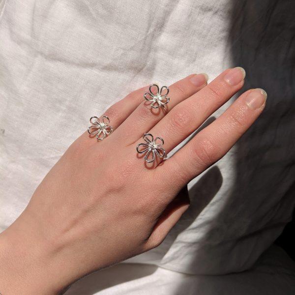 Hand wearing three flow rings