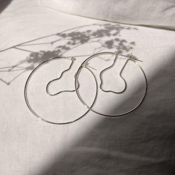 Silver lagoon hoop earrings with shadow of flowers