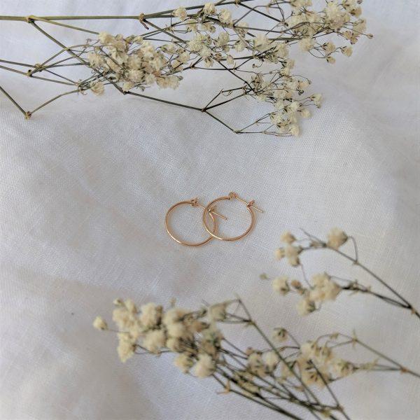 gold stream hoops framed by flowers
