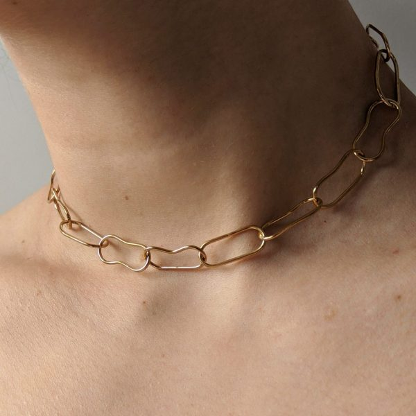 Close up of gold choker on model
