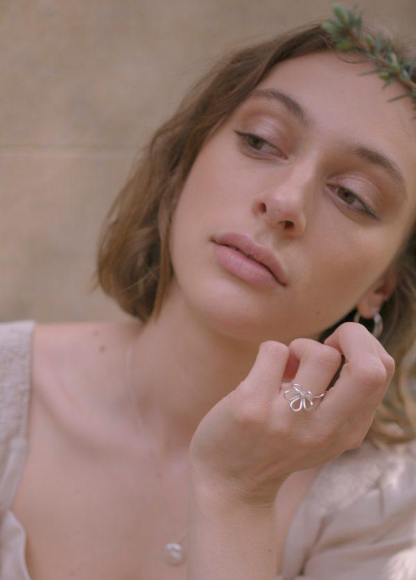 model wearing flow ring