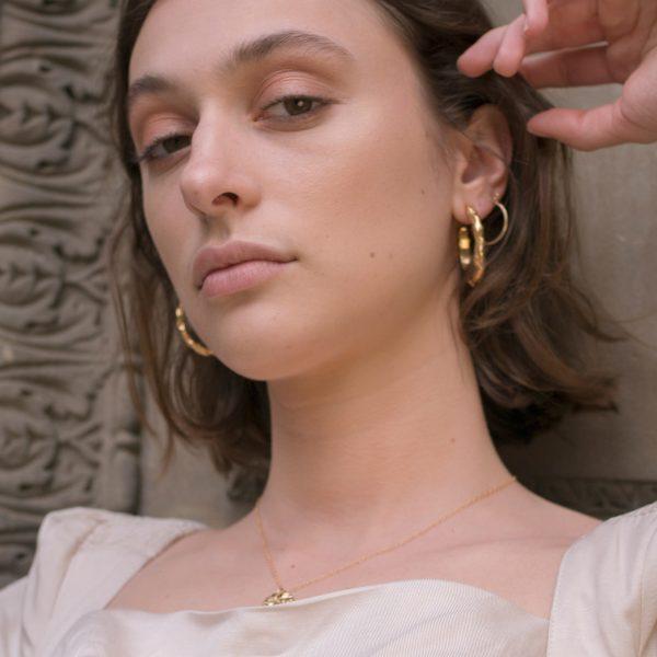 Model wearing stream hoops