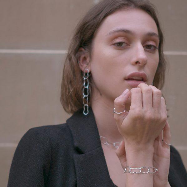 Model wearing droplet bracelet