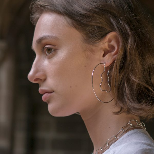 Model wearing silver lagoon hoop earrings