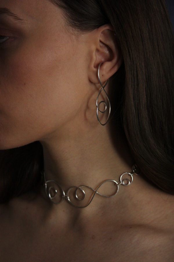 silver prevail necklace and ear cuff on model