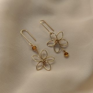 Gold flora earrings with yellow gem