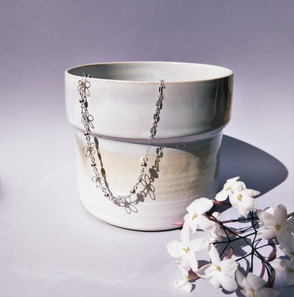 carnations necklace styled on pot