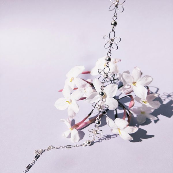 carnation necklace silver on flowers