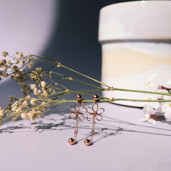 jasmine earrings on stem styled with pot