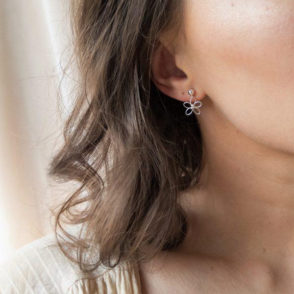 wildflower earrings on model