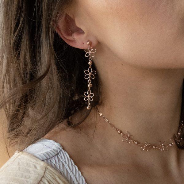 carnation earrings in rose on model