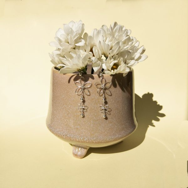 chrysanth earrings styled with pot and flowers