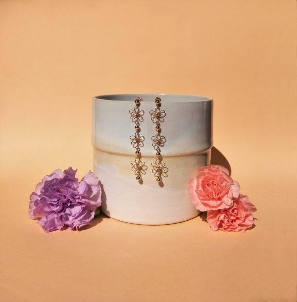 carnation earrings styled with pot and flowers