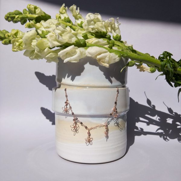 snapdragon necklace styled with pot and flowers