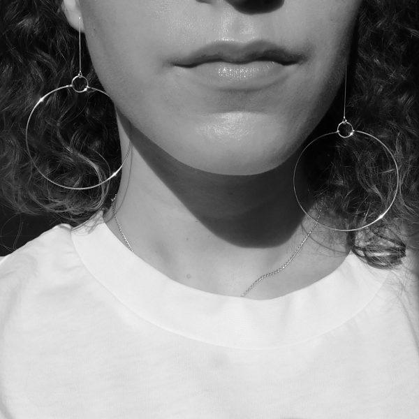 Mixed length terrestrial earrings on model