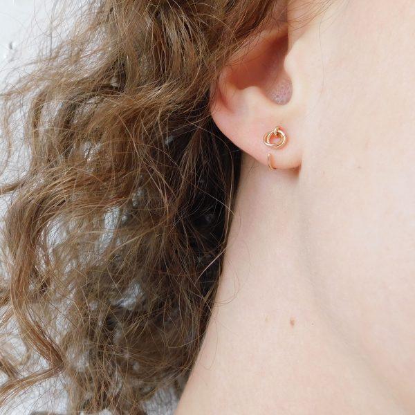 model wearing alto ear hugger earrings