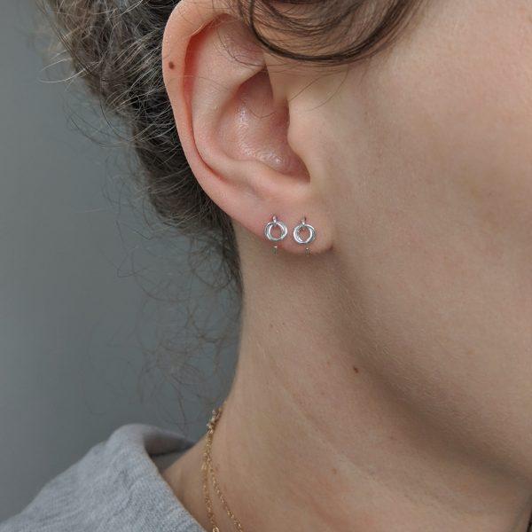 silver alto earrings on model