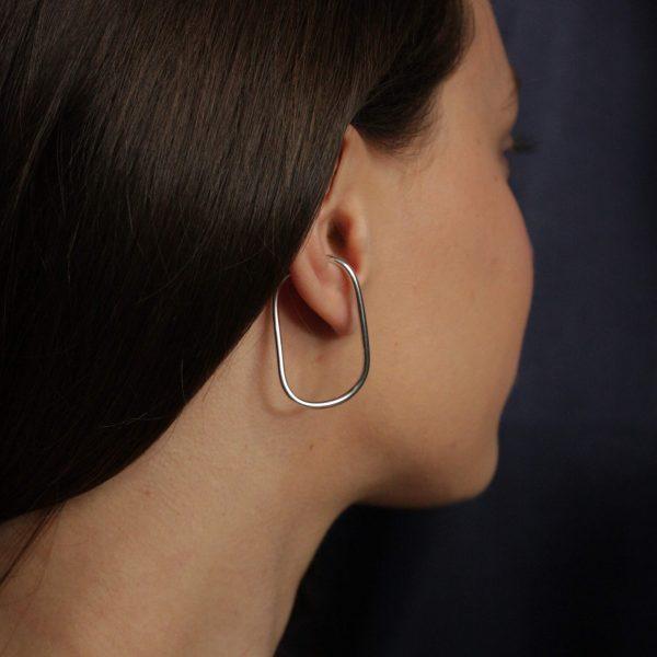 silver eternal ear cuff on model