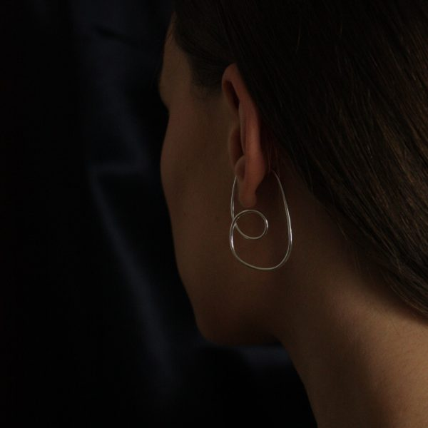 silver divinity ear cuff on model