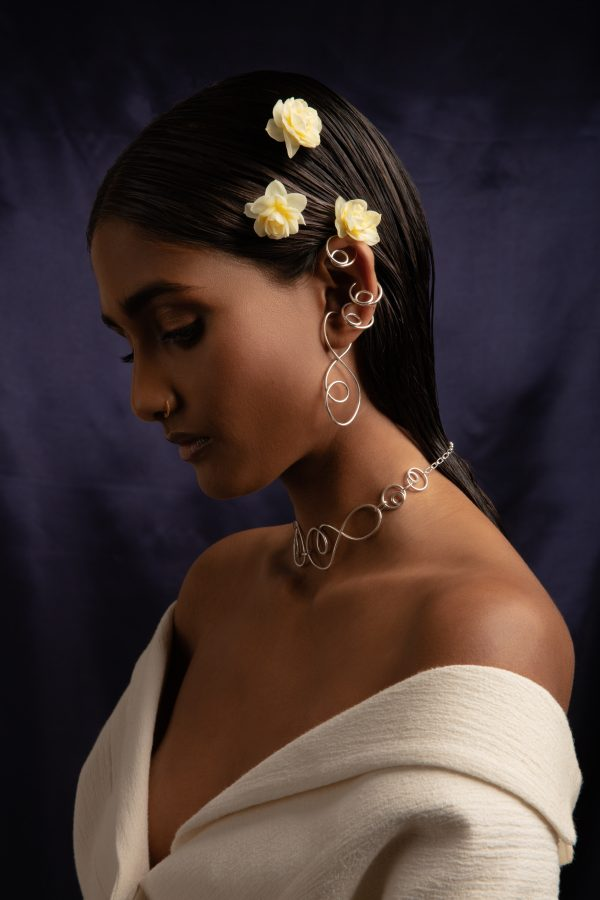 model wears prevail choker, prevail ear cuff and elevate ear cuffs