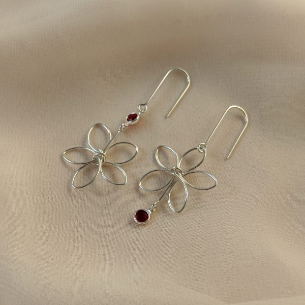 Silver flora earrings with red gem