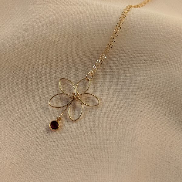 Gold flora necklace with red gem