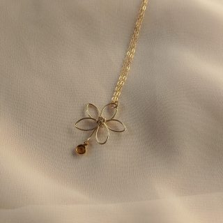 Gold flora necklace with yellow gem