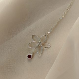 Silver flora necklace with red gem