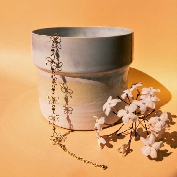 carnation bracelet styled with pot and flowers