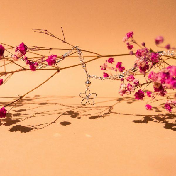 sea lavender bracelet or anklet hanging on flower stems