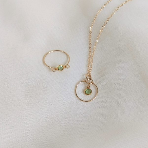 Gem necklace and ring in gold peridot