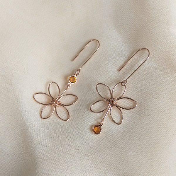 rose gold flora earrings yellow gem