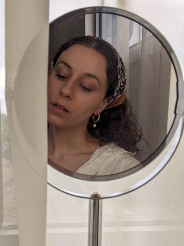 gold heirloom earrings on ears