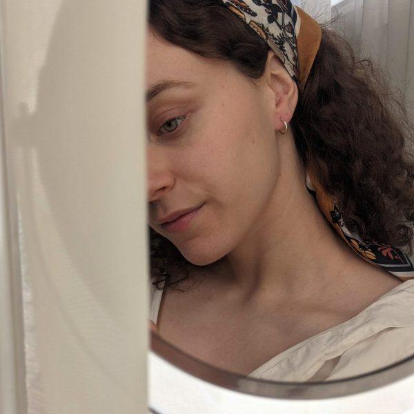 silver repertoire earrings on ear