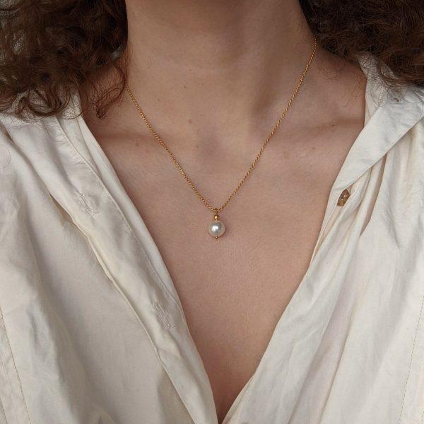 gold ornate necklace on neck