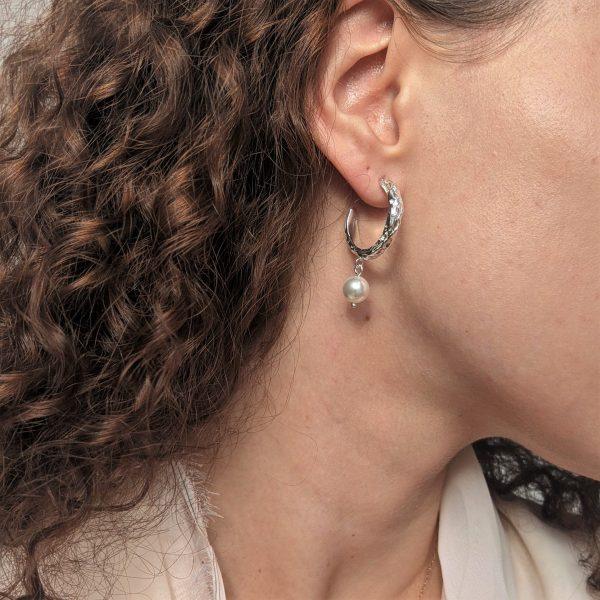 silver heirloom earrings on ear